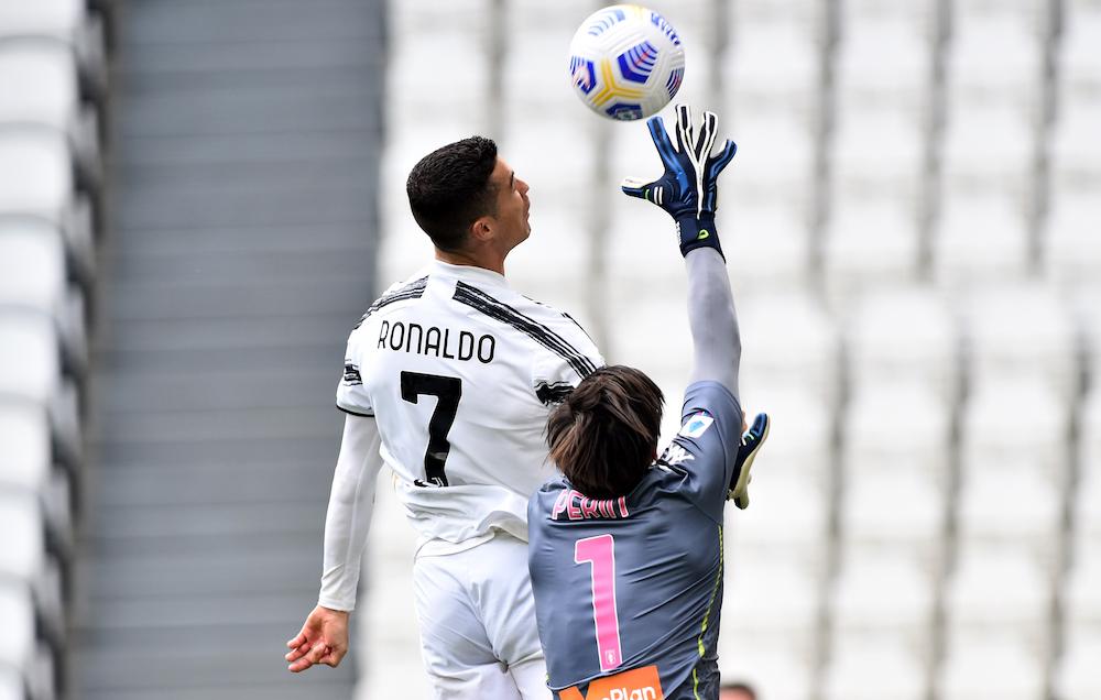 Juventus' Cristiano Ronaldo in action with Genoa's Mattia Perin at the Allianz Stadium, Turin, Italy April 11, 2021 — Reuters pic