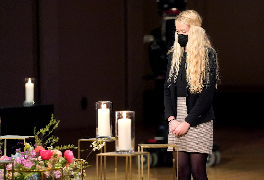 The daughter of a victim of Covid-19 pandemic attends a memorial ceremony, in Berlin, Germany April 18, 2021.