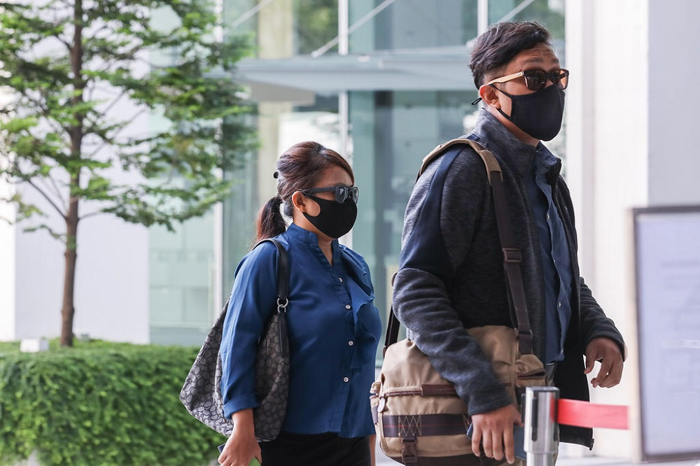 Khairul Annuar Zakaria (right) and Noorain Jubli are seen arriving State Courts on April 21, 2021. — TODAY pic