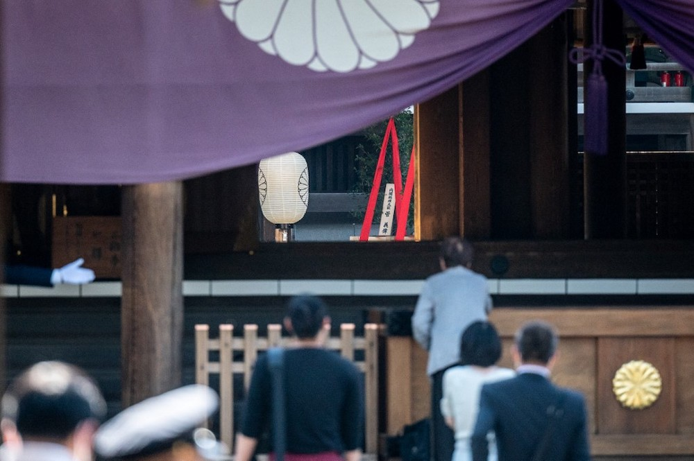 A ritual offering sent by Japanese Prime Minister Yoshihide Suga (centre) is seen during the annual spring rites at the Yasukuni Shrine in Tokyo on April 21, 2021. — AFP pic