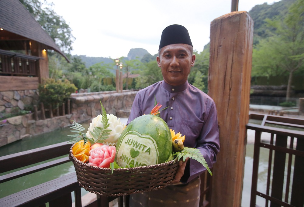 During the ceremony, the 'newlyweds' were fed a basket of fruits to celebrate their union. — Picture by Farhan Najib