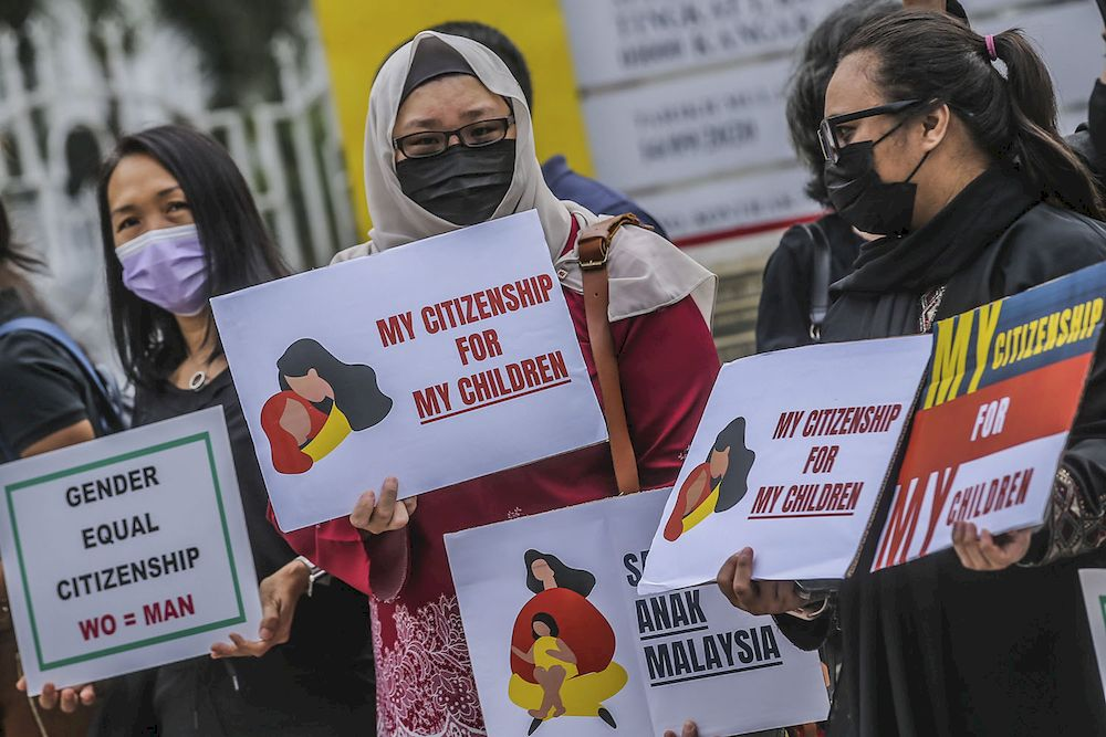 Members of Family Frontiers and the affected Malaysian mothers are seen holding placards to say that their children should also have the right to be Malaysian citizens, April 27, 2021. ― Picture by Hari Anggara
