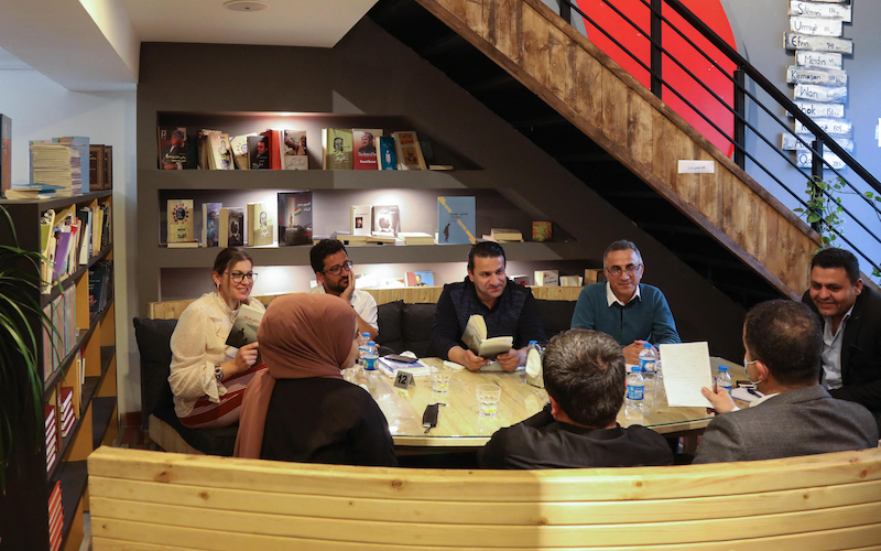 Members of a book club meet to review a novel at a book store in Arbil, the capital of the autonomous Kurdish region of northern Iraq April 9, 2021. — AFP pic