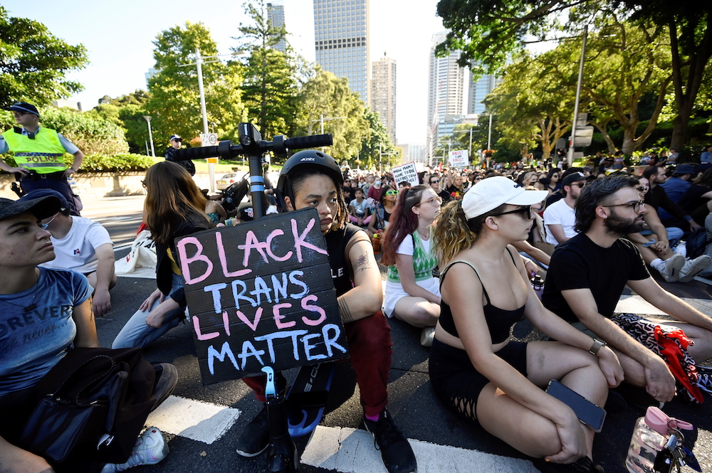 Protesters sit in a one minute silence during a rally to mark a national day of action, protesting against Aboriginal deaths in police custody, in Sydney, Australia, April 10, 2021. — Reuters pic