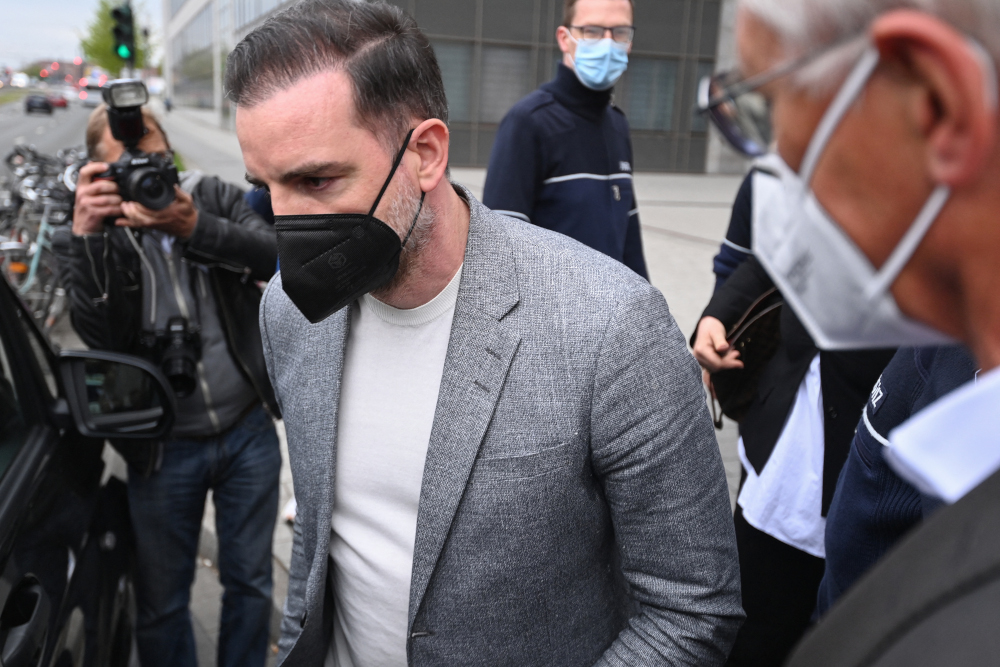 Former German footballer Christoph Metzelder leaves the district court after the trial against him on child pornography charges in Duesseldorf, western Germany April 29, 2021. — AFP pic