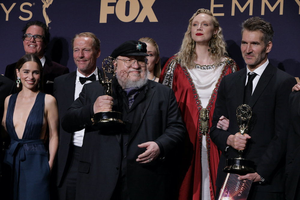 George R.R. Martin (centre) and the cast and crew of Game of Thrones poses backstage with their award for Outstanding Drama Series at the 71st Primetime Emmy Awards in Los Angeles, September 22, 2019. — Reuters pic
