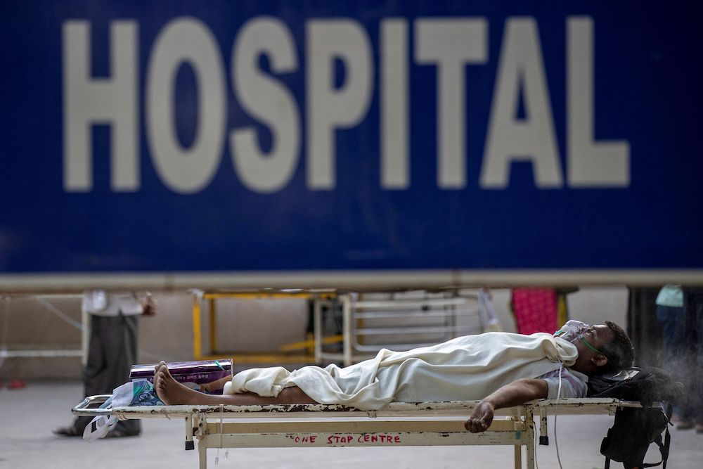 A patient suffering from the coronavirus disease waits to get admitted outside the casualty ward at Guru Teg Bahadur hospital, amidst the spread of the disease in New Delhi, India, April 23, 2021. — Reuters pic