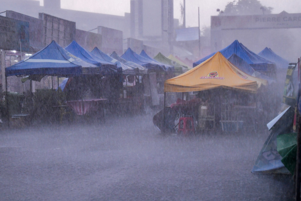 Heavy rain and strong winds prevented traders from selling their food at the Kampung Baru Ramadan bazaar, April 13, 2021. — Bernama pic