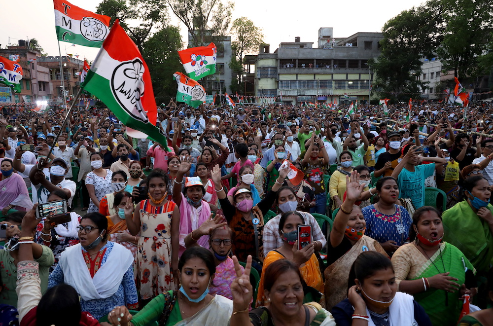 Supporters of the Chief Minister of the eastern state of West Bengal and Trinamool Congress Chief, Mamata Banerjee, attend an election campaign rally ahead of the forth phase of the state election, amidst the spread of Covid-19, in Kolkata, India, April 7