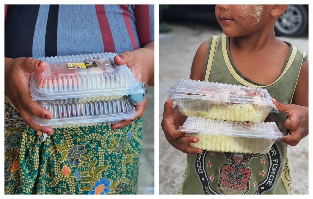 Some of Beserah's poor and homeless people receiving chicken rice packets through last year's initiative. — Picture by Aiman Azahari