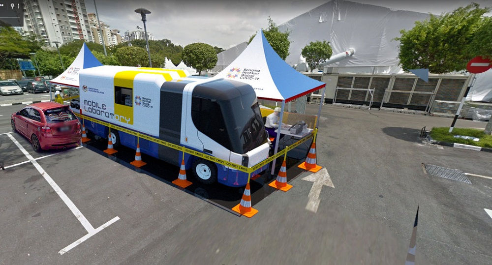 An artist rendition of NGT Solutions' mobile laboratory being deployed in a community centre. The mobile lab or MoLAB is able to provide accurate Covid-19 screening with results issued within two hours. ― Picture by Danial Dzulkifly