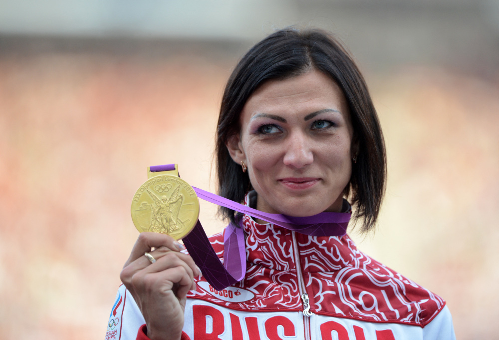 In this file photo taken August 9, 2012, Russia's gold medalist Natalya Antyukh poses on the podium of the women's 400 hurdles at the athletics event of the London 2012 Olympic Games in London. — AFP pic