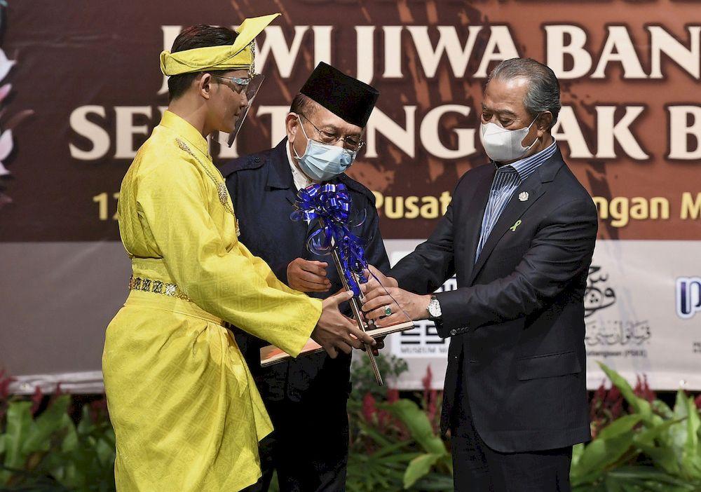Prime Minister Tan Sri Muhyiddin Yassin (right) launching the book 'Budi Asas Tamadun' and the Jawi Jiwa Bangsa Exhibition, the Art of Cultural Pillars at the Malaysia Tourism Centre, Kuala Lumpur, April 12, 2021. — Bernama pic