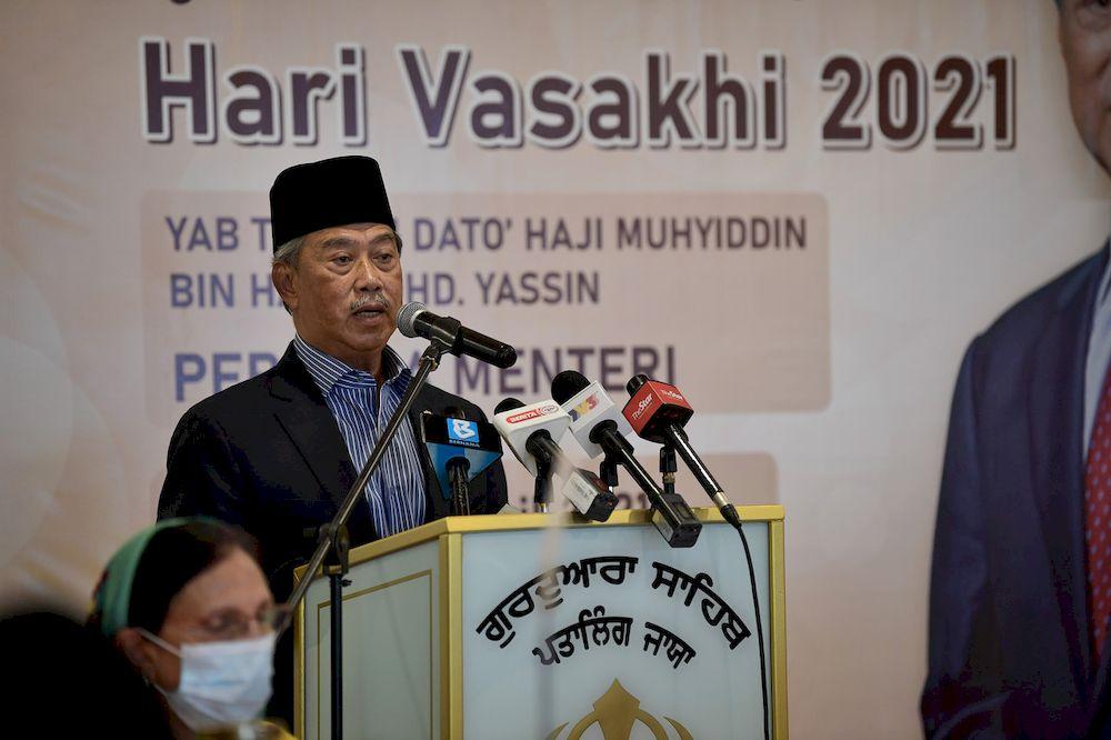 Prime Minister Tan Sri Muhyiddin Yassin speaking at a function in conjunction with the Vaisakhi festival at Gurdwara Sahib Lorong Utara, Petaling Jaya, April 12, 2021. — Bernama pic