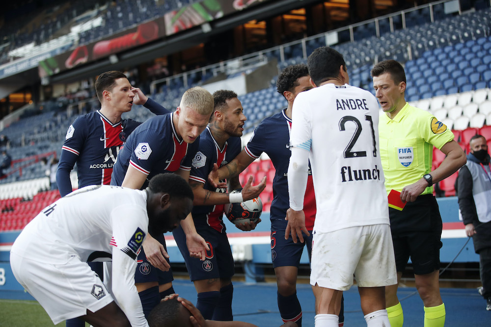 Paris St Germain's Neymar remonstrates with referee after he was shown a red card during the match against Lille at Parc de Princes in Paris, April 4, 2021. — Reuters pic