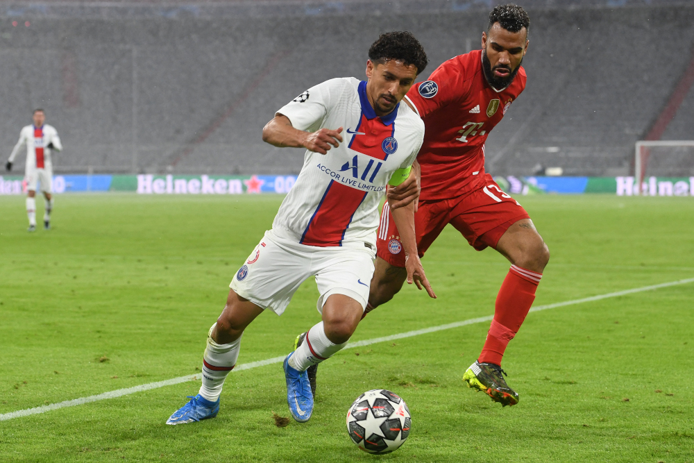 Paris Saint-Germain defender Marquinhos and Bayern Munich forward Eric Maxim Choupo-Moting vie for the ball during the Uefa Champions League quarter-final first leg football match in Munich, southern Germany, April 7, 2021. — AFP pic