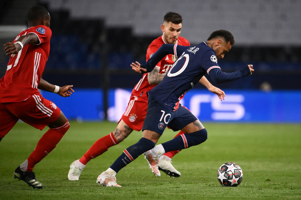 Paris Saint-Germain forward Neymar drives the ball during the Uefa Champions League quarter-final second leg football match against FC Bayern Munich at the Parc des Princes stadium in Paris, April 13, 2021. — AFP pic