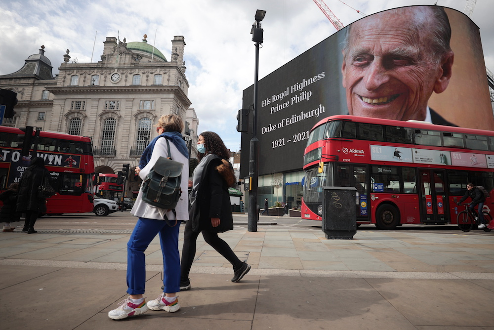 A screen with a picture and a message about Britain's Prince Philip, husband of Queen Elizabeth, is seen at Piccadilly Circus after he died at the age of 99, in London, Britain, April 9, 2021. — Reuters pic