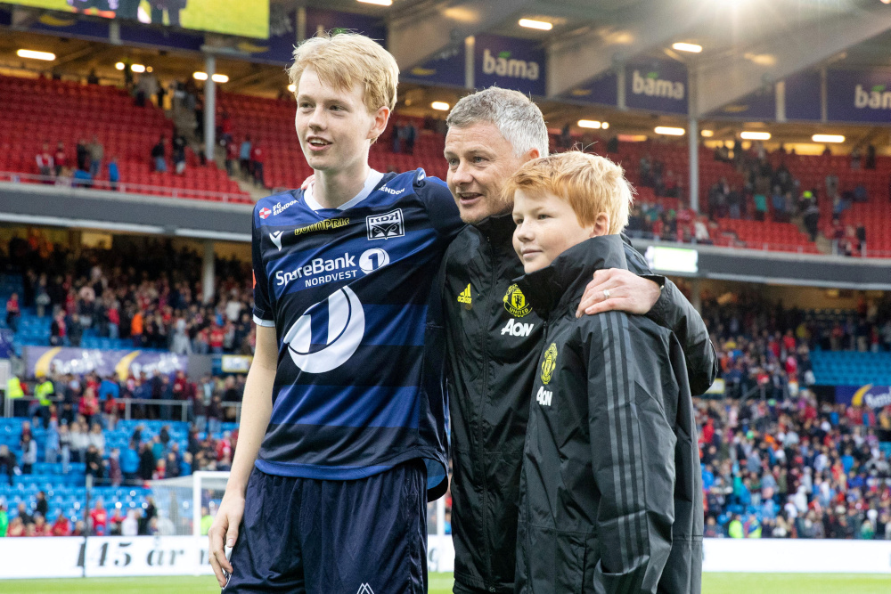 Manchester United manager Ole Gunnar Solskjaer poses with his sons Elijah Solskjaer and Kristiansund's Noah Solskjaer in Oslo, Norway, July 30, 2019. — NTB Scanpix/Audun Braastad pic via Reuters