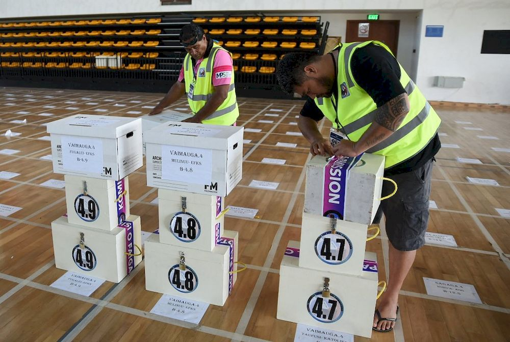 A handout photo taken and received on April 9, 2021 from the Samoa Electoral Commission shows ballot boxes arriving for counting during the general election in the capital city of Apia. — Samoa Electoral Commission / AFP pic
