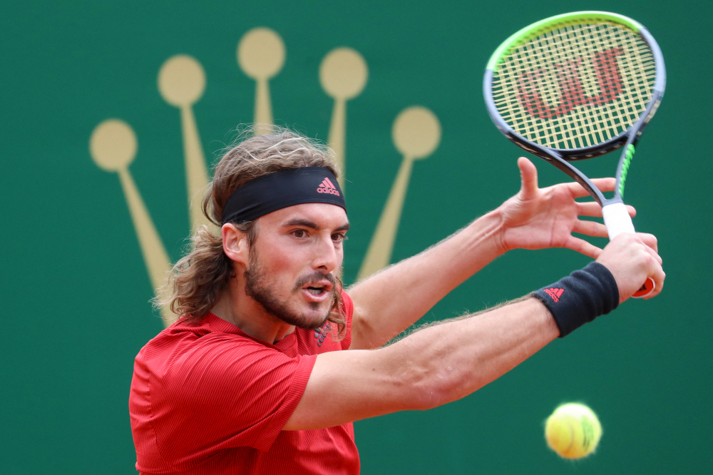 Greece's Stefanos Tsitsipas plays a return during his quarter final singles match against Spain's Alejandro Davidovich Fokina on day seven of the Monte-Carlo ATP Masters Series tournament in Monaco April 16, 2021. — AFP pic