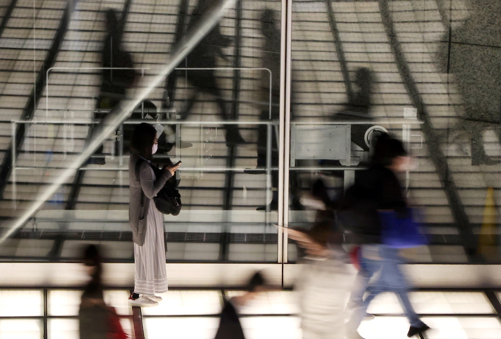 Passersby wearing protective face mask walk past a concourse amid the coronavirus disease outbreak in Tokyo, Japan April 16, 2021. Picture taken April 16, 2021. — Reuters pic