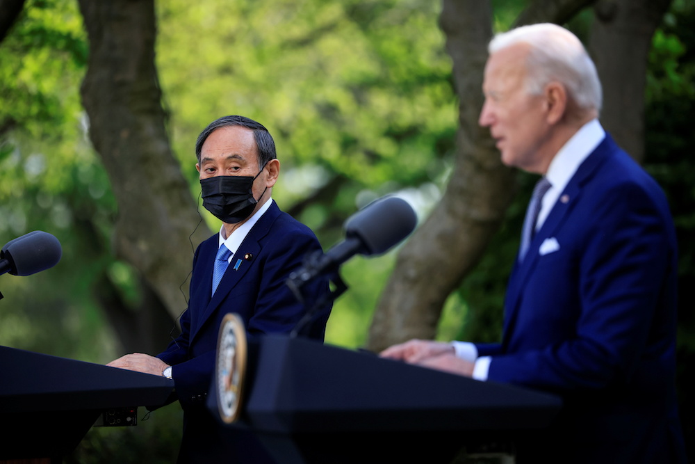 Japan's Prime Minister Yoshihide Suga and US President Joe Biden hold a joint news conference in the Rose Garden at the White House in Washington, US, April 16, 2021. — Reuters pic
