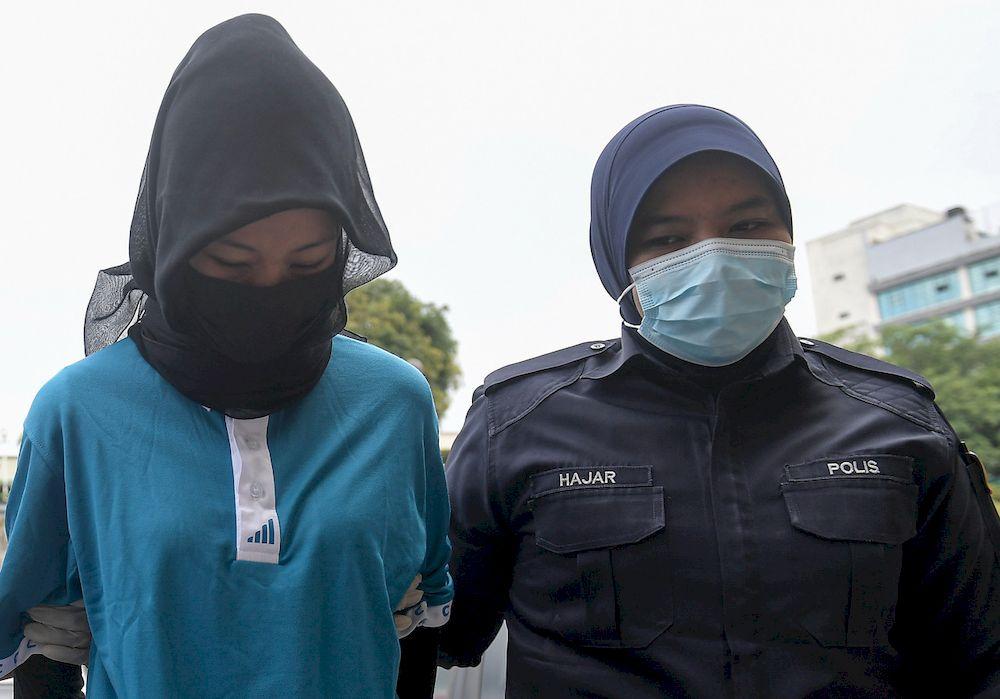 File picture shows Umiezatul Asyikin Nasrun being brought before the Bandar Baru Bangi Magistrate's Court, March 12, 2021. — Bernama pic