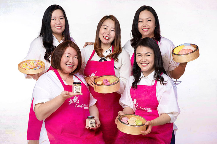 Lim (seated, left) and her Zoey's Homemade team.