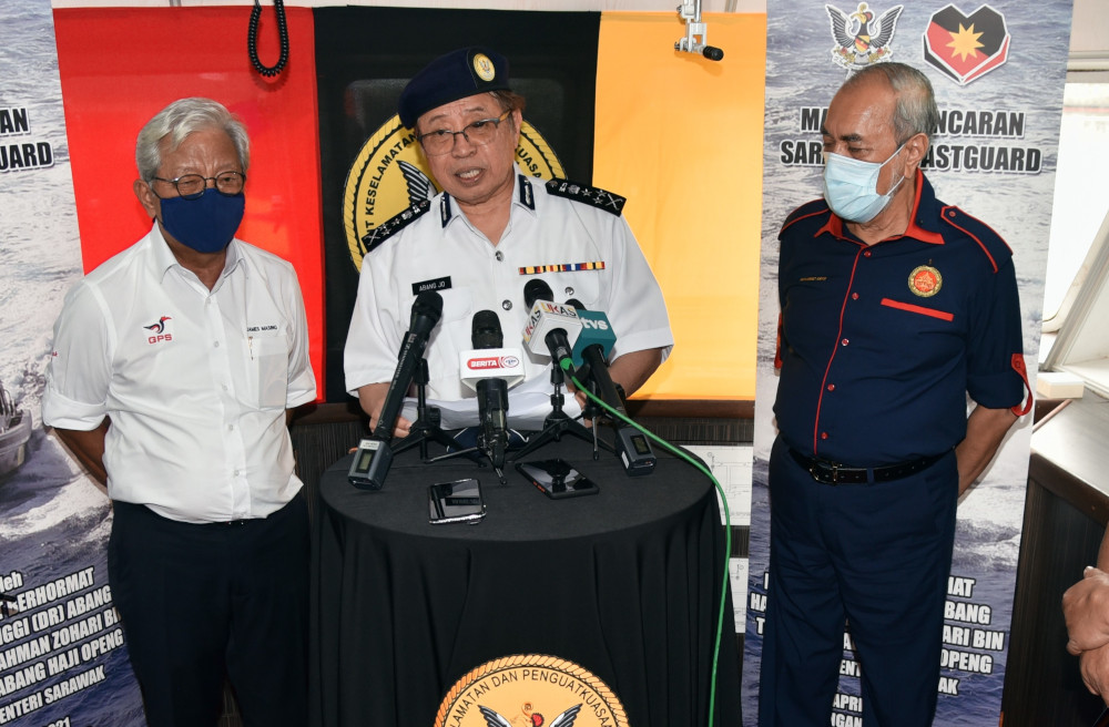 Chief Minister Datuk Patinggi Abang Johari Openg (centre) speaking to reporters, says the Covid-19 situation is under control, April 7, 2021. — Picture by Sarawak Public Communication Unit (Ukas).