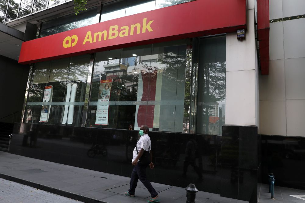 A man wearing a protective mask walks past an AmBank branch in Kuala Lumpur September 9, 2020. — Reuters pic