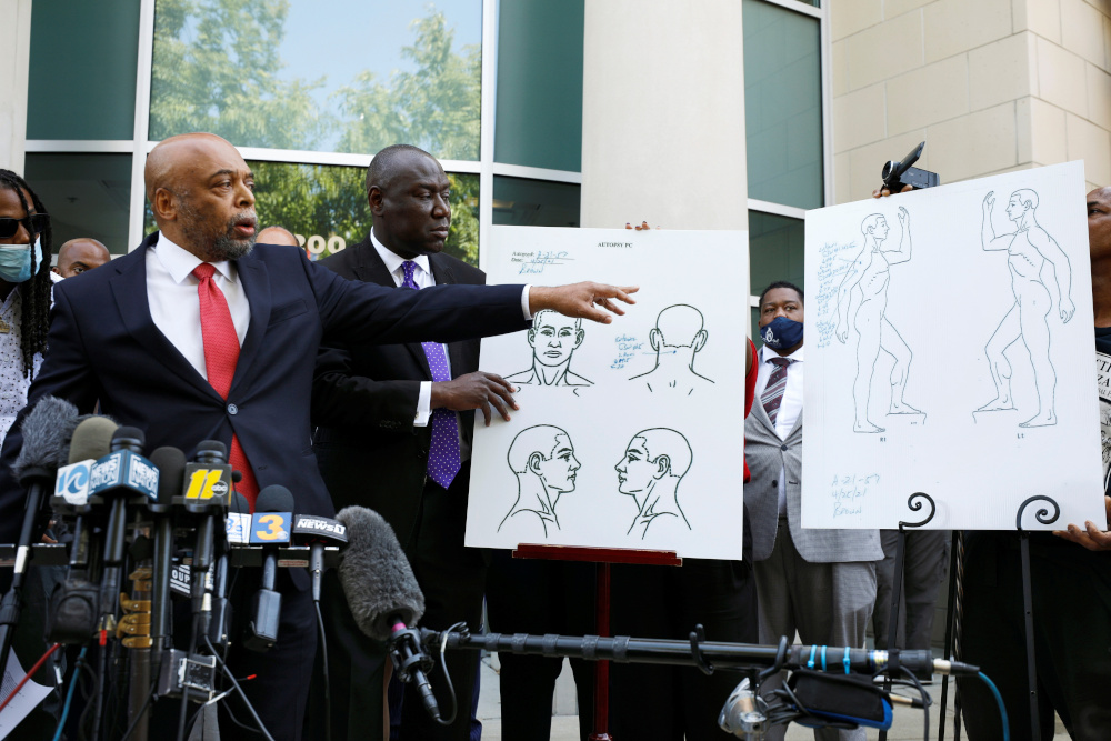 Attorneys Wayne Kendall and Ben Crump refer to diagrams identifying the bullet wounds sustained by Andrew Brown Jr at a news conference announcing findings from an independent autopsy into the killing of Brown by sheriffs last week, in Elizabeth City, North Carolina, US, April 27, 2021. — Reuters pic
