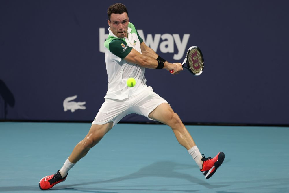Roberto Bautista Agut of Spain hits a backhand against Daniil Medvedev of Russia in a men's singles quarterfinal in the Miami Open at Hard Rock Stadium, Miami March 30, 2021. — Reuters pic
