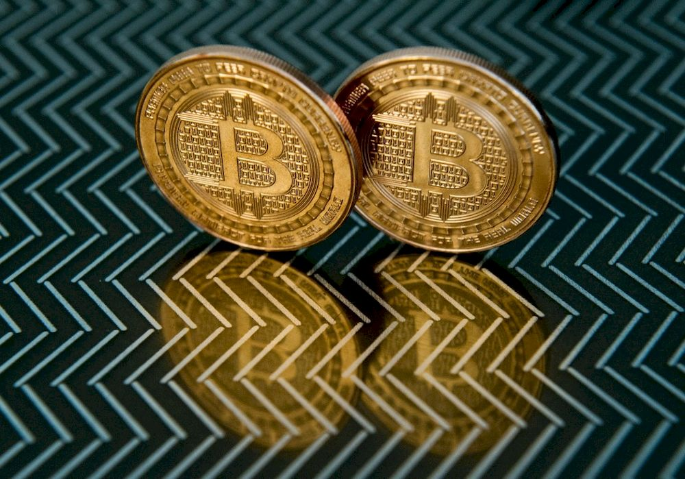 In this file photo taken on June 17, 2014 in Washington, DC bitcoin medals are pictured. — AFP pic