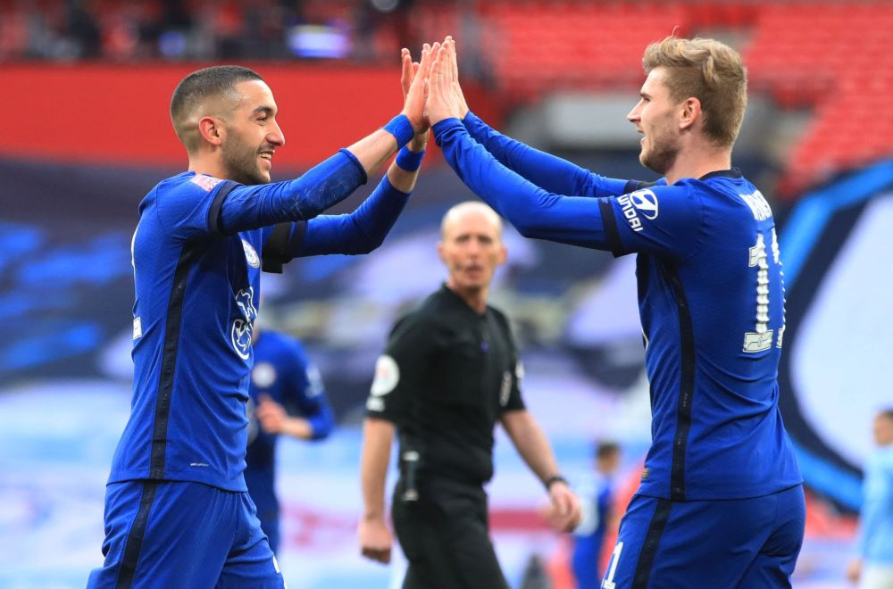 Chelsea's Hakim Ziyech (left) celebrates scoring their first goal against Manchester City with Timo Werner at the Wembley Stadium, London April 17, 2021. — Reuters pic