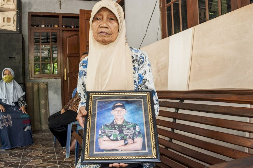 Sarikem holds a photo of her grandson Gunadi Fajar Rahmanto at their home in Yogyakarta on April 26, 2021, a crew member of the submarine that disappeared off the coast of Bali. — AFP pic