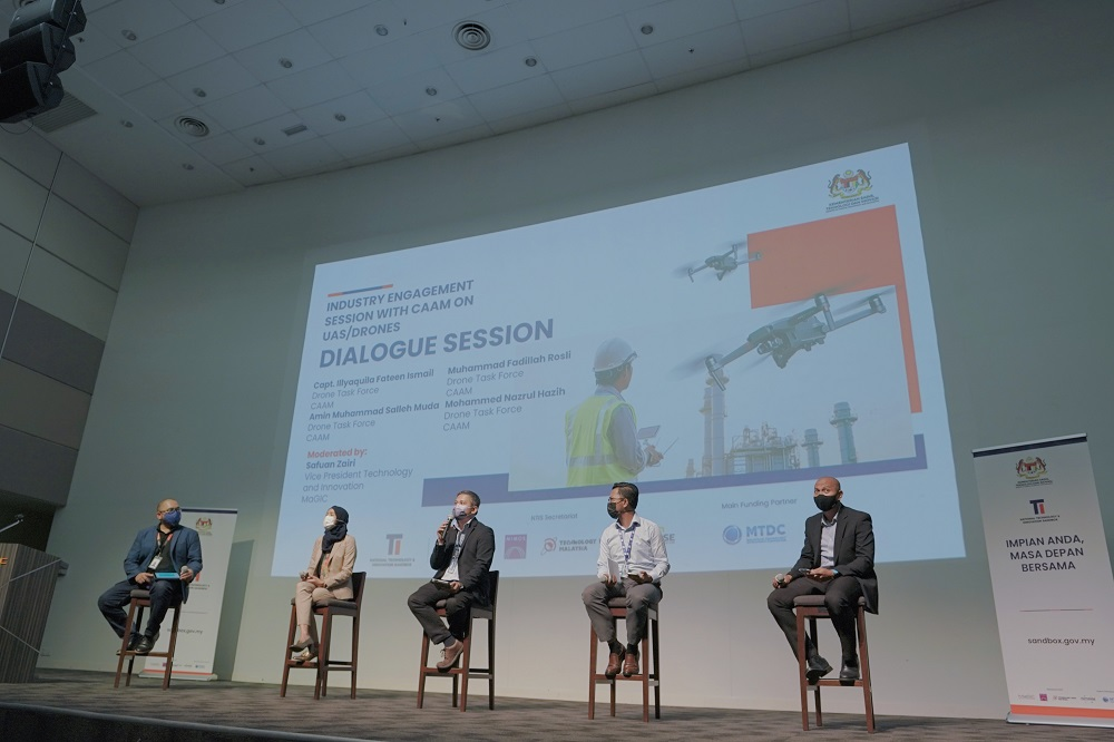 (From left) MaGIC senior vice president (Technology and Innovation) Safuan Zairi, CAAM drone task force captain, Illyaquila Fateen Ismail, Muhammad Fadillah Rosli, Amin Muhammad Salleh Muda and Mohammed Nazrul Hazih at a dialogue session. ― Picture courtesy of Malaysian Global Innovation & Creativity Centre
