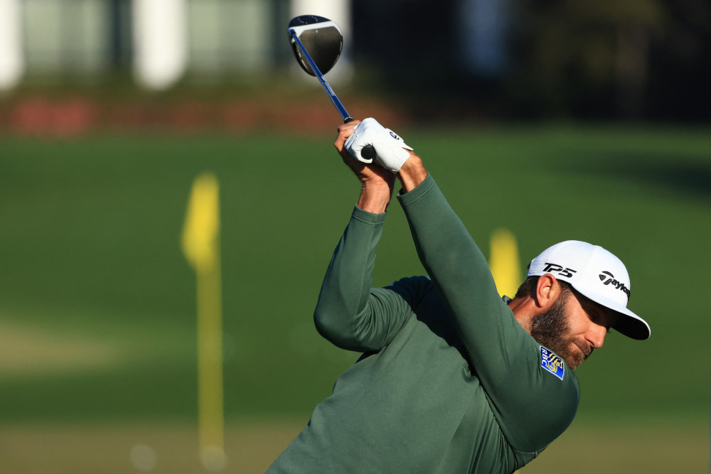 Dustin Johnson of the United States hits on the range during a practice round prior to the Masters at Augusta National Golf Club April 5, 2021 in Augusta, Georgia. — Mike Ehrmann/Getty Images via AFP