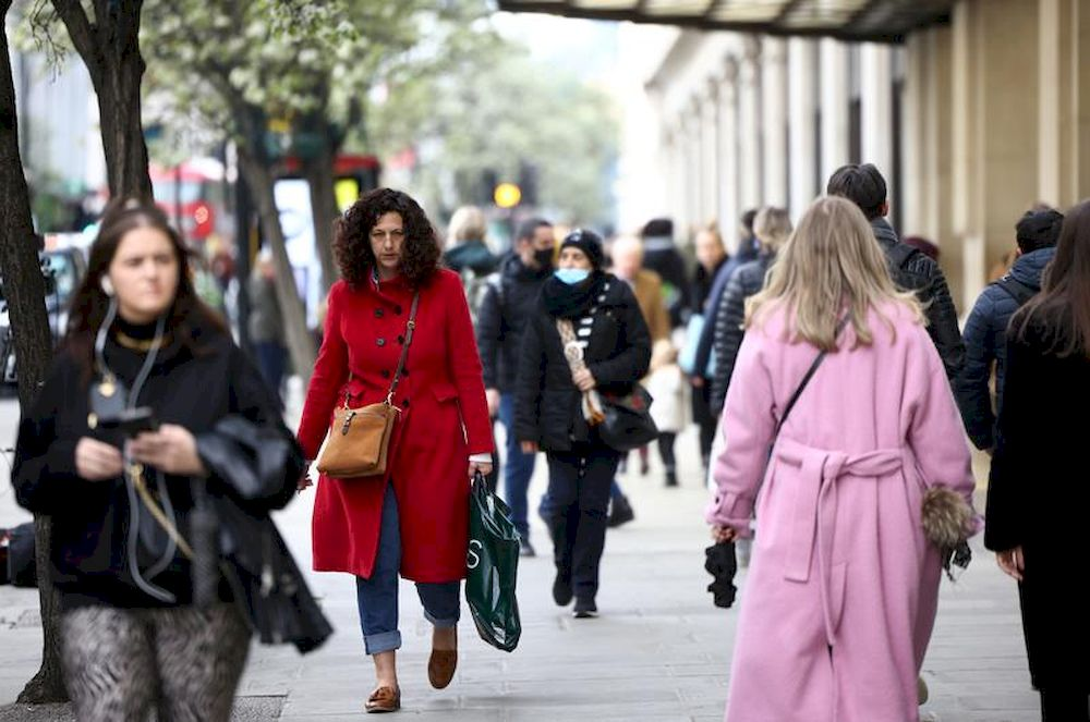 People walk on a street, as the coronavirus disease (Covid-19) restrictions ease, in London, Britain April 12, 2021. — Reuters pic