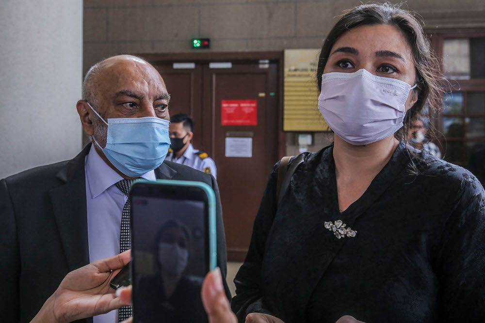 Lawyer Datuk Gurdial Singh Nijar (left) and Family Frontiers president Suriani Kempe at the Kuala Lumpur High Court Complex April 27, 2020. — Picture by Hari Anggara
