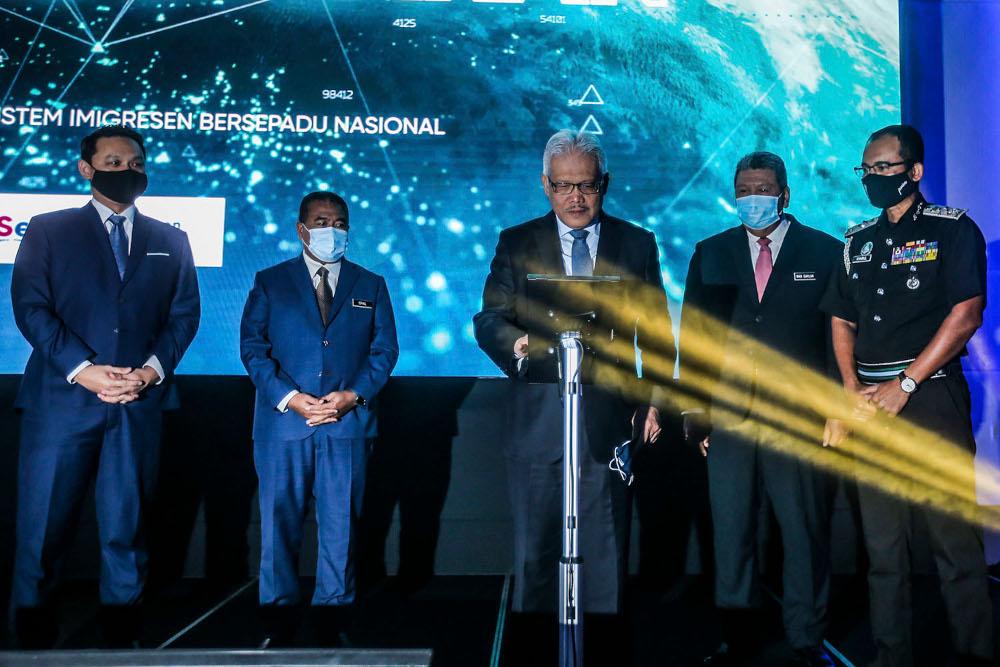 Home Minister Datuk Seri Hamzah Zainudin (centre) at the launch of the new National Immigration Systems at Hilton Kuala Lumpur April 8, 2021. ― Picture by Hari Anggara
