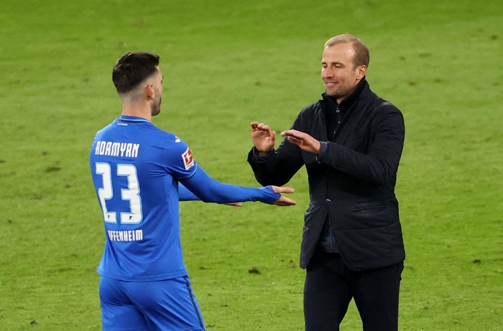TSG 1899 Hoffenheim coach Sebastian Hoeness celbrates with Christoph Baumgartner after the match April 17, 2021. ― Pool via Reuters