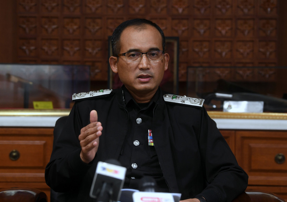 Immigration director-general Datuk Khairul Dzaimee Daud speaking at a press conference on foreigners with expired Social Visit Passes in Putrajaya, April 21, 2021. — Bernama pic
