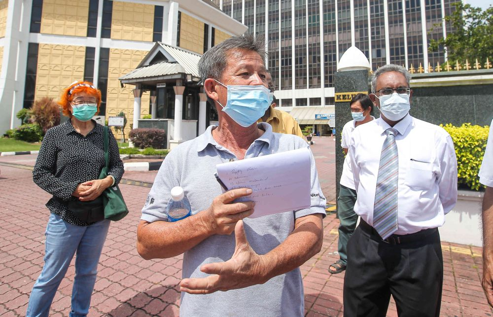 Farmer Tan Tean Chee speaks to reporters outside the Ipoh City Council April 1, 2021. — Picture by Farhan Najib