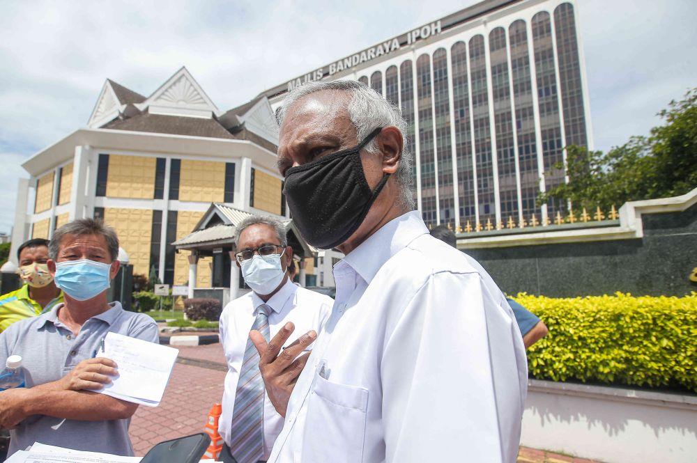 Parti Sosialis Malaysia chairman Dr Jeyakumar Devaraj speaks to reporters outside the Ipoh City Council April 1, 2021. — Picture by Farhan Najib