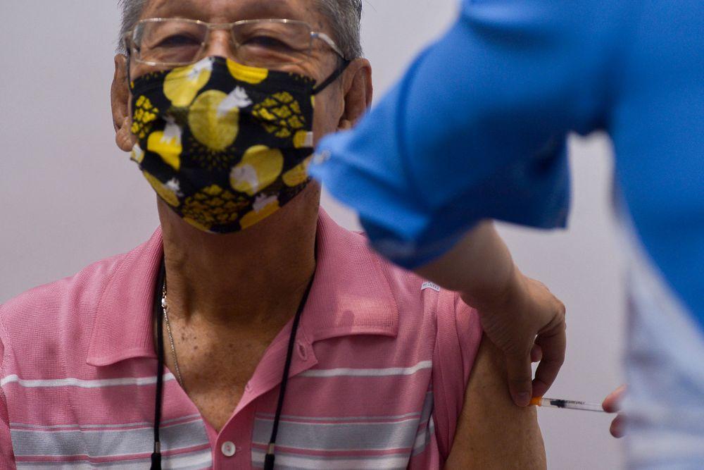 A senior citizen receives his Covid-19 jab at a vaccination centre in Kapar, Klang April 28, 2021. — Picture by Miera Zulyana