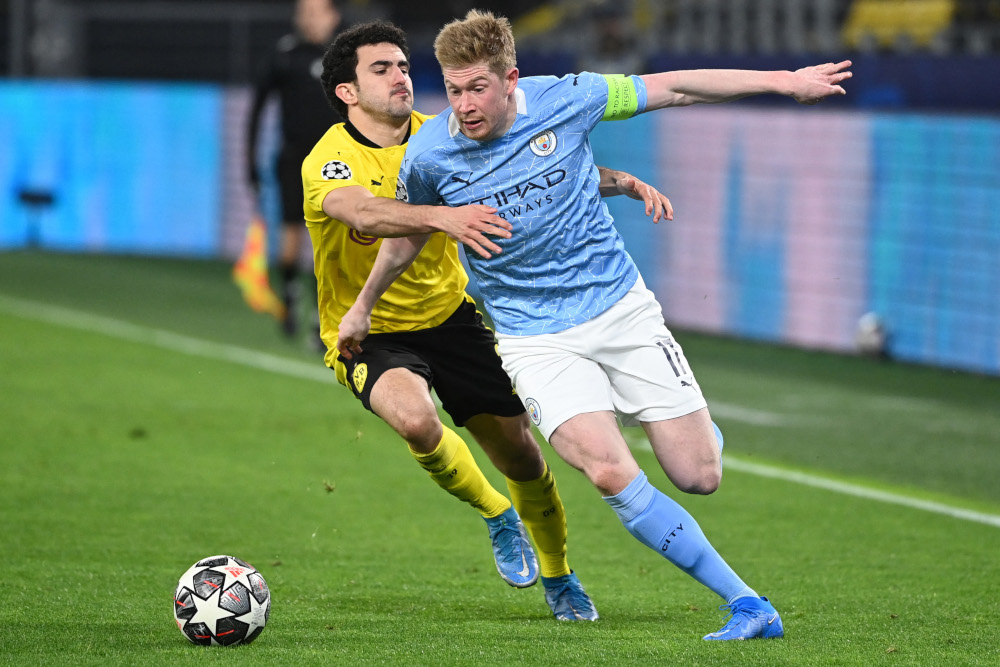 Dortmund defender Mateu Morey and Manchester City midfielder Kevin De Bruyne vie for the ball during the Uefa Champions League quarter-final second leg football match in Dortmund, western Germany, April 14, 2021. — AFP pic