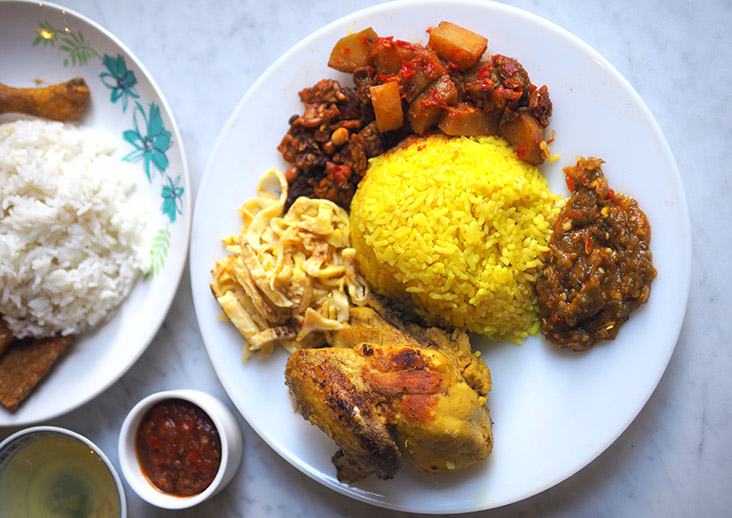 'Nasi kuning' is another must-eat here paired with 'ayam bakar', 'tempe', diced potatoes, shredded omelette and a super addictive 'sambal balado'