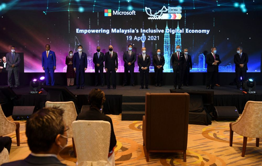 Prime Minister Tan Sri Muhyiddin Yassin (centre) attends the launch of Microsoft's 'Bersama Malaysia' initiative in Putrajaya April 19, 2021. — Bernama pic