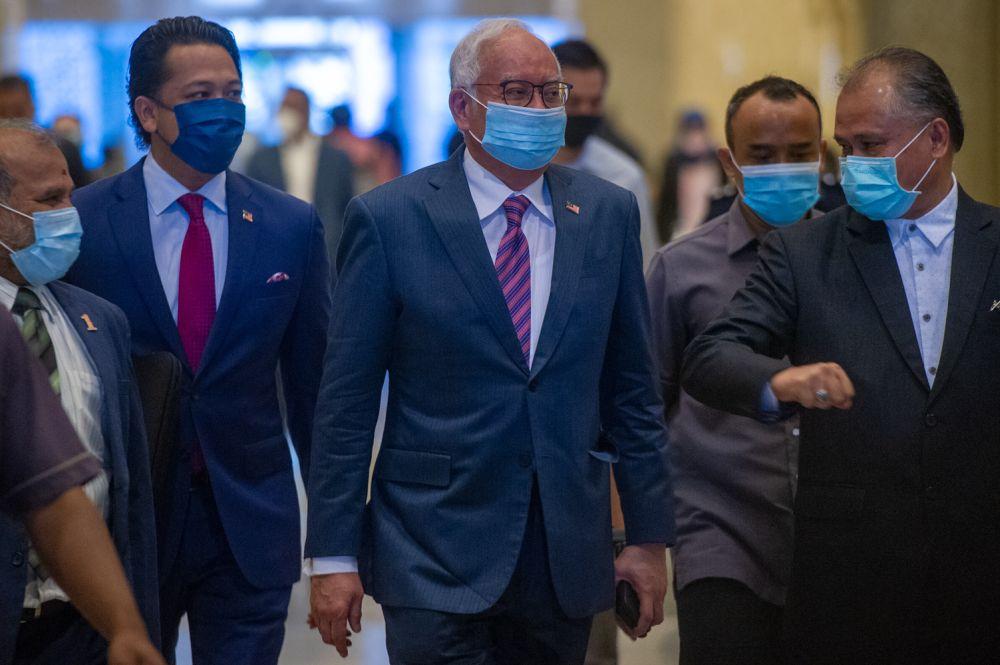 Datuk Seri Najib Razak arrives at the Court of Appeal in Putrajaya April 22, 2021. — Picture by Shafwan Zaidon